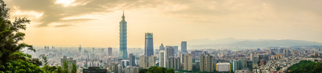 Panoramic of beautiful landscape and cityscape of taipei 101 building and architecture in the city skyline at sunset time in Taiwan