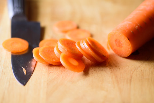 Sliced carrot on wooden board preparing for cooking