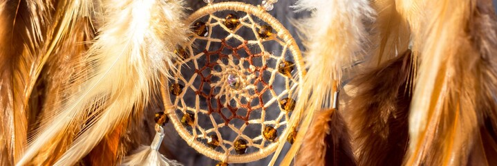 Banner of Handmade dream catcher with feathers threads and beads rope hanging