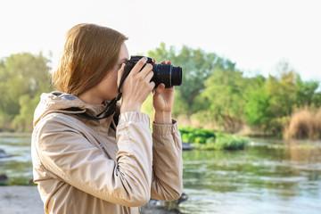 Female tourist taking photo of river