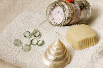 Soap and sea salt on a white bath towel