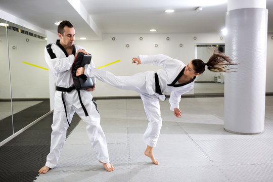 Martial artists showing dedication and discipline in taekwondo