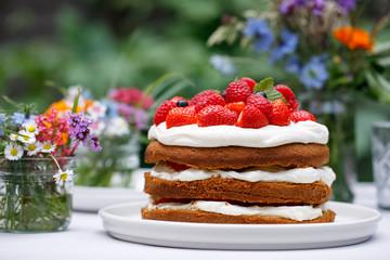 Scandinavian midsummer feast with strawberry cake