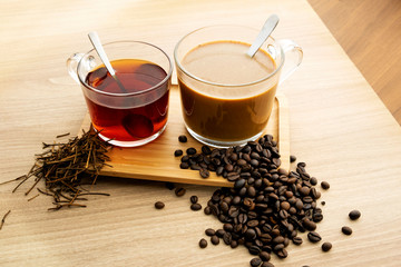 Foto op Canvas Thee Hot tea and coffee With tea leaves and coffee beans