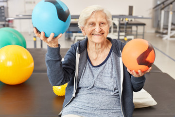 Senior woman balances balls in occupational therapy