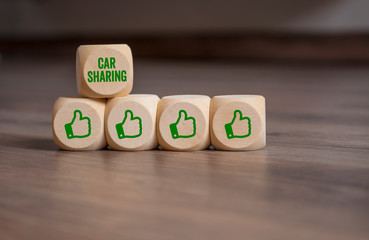 Cubes and dice with thumbs up and Car sharing on wooden background