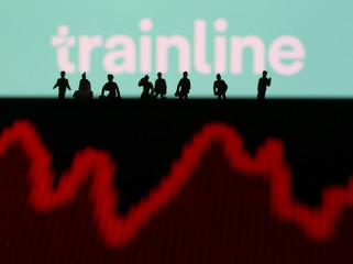 Trainline logo is displayed behind small toy figures and a stock graph in this illustration picture