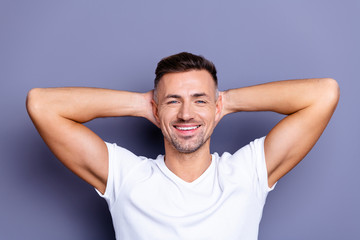 Close up photo amazing he him his middle age macho perfect appearance teeth hands arms behind head overjoyed imaginary flight refreshment time wear casual white t-shirt isolated grey background