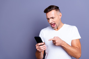 Close up photo amazing he him his middle age yell macho perfect appearance telephone hands arms misunderstanding wife girlfriend skype quarrel wear casual white t-shirt isolated grey background