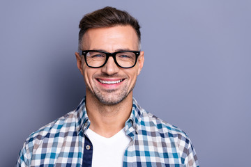Close up photo handsome attractive he him his guy intelligent reliable manager person peacefully cute funny smile neat bristle beard wear specs casual plaid checkered shirt isolated grey background