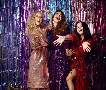 Party and holidays concept. Three glamour women in luxury glitter sequins dress having fun.
