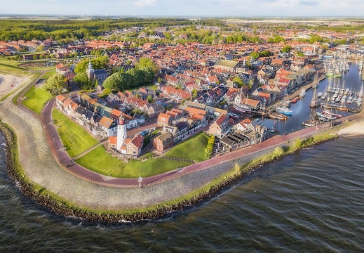 Aerial view of Urk with its lighthouse, a small coastal village on the IJsselmeer in the Netherlands..