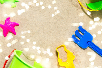 childhood and summer concept - close up of sand toys kit on beach