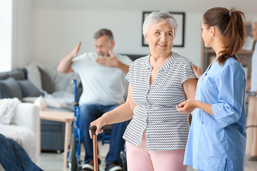Elderly woman with caregiver in nursing home