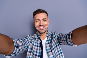 Self-portrait of his he nice-looking attractive well-groomed cheerful cheery bearded guy wearing checked shirt isolated over gray blue pastel background