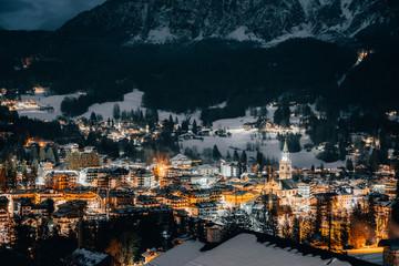 Scenic night view over Cortina d'Ampezzo in winter. Cortina d'Ampezzo is located in Dolomites, Italy.