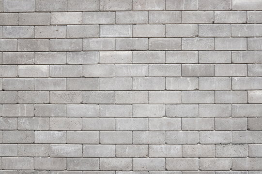Old cinder block wall background, brick texture and background.