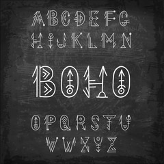 Tribal alphabet. Hand-drawn vector ethnic font. Boho style letters on chalk board.