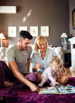 Parents with child playing with puzzles