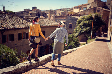 tourists couple at the Italy visiting Toscana..