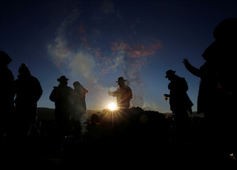 Aymara witchdoctors participate in a winter solstice ceremony that coincides with the Aymara Indian New Year in Tiwanaku