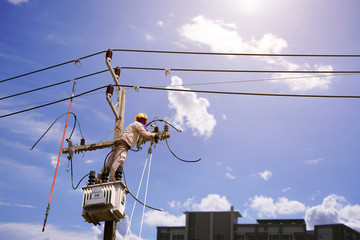 Silhouette person technicians workers on high voltage transmission systems