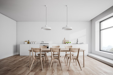 White kitchen interior with wooden table