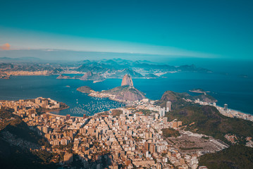 Foto op Canvas Brazilië The skyline of Rio de Janeiro with the Sugar Loaf from the helicopter