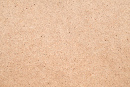 Construction material. Beige plywood texture abstract art background. Solid color LDF surface. Empty space.
