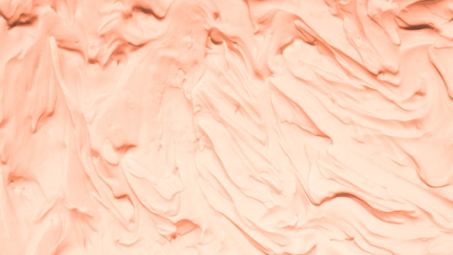 Peach foam texture abstract art background. Smeared whipped cream design surface.