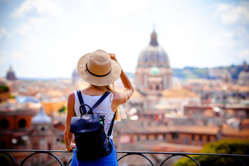 Rome Europe Italia travel summer tourism holiday vacation background -young smiling girl with mobile phone camera and map in hand standing on the hill looking on the cathedral Vatican Fotomurales