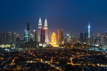 Kuala lumpur cityscape. Panoramic view of Kuala Lumpur city skyline during sunrise viewing skyscrapers building and Petronas twin tower in Malaysia.
