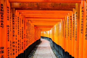 Red Tori Gate at Fushimi Inari Shrine in Kyoto, Japan.