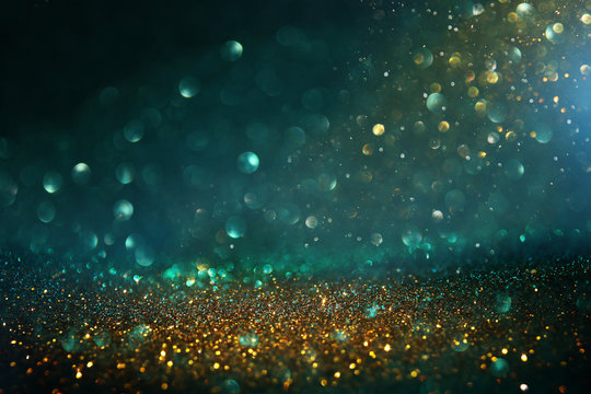 abstract glitter lights background. black, blue, gold and green. de-focused