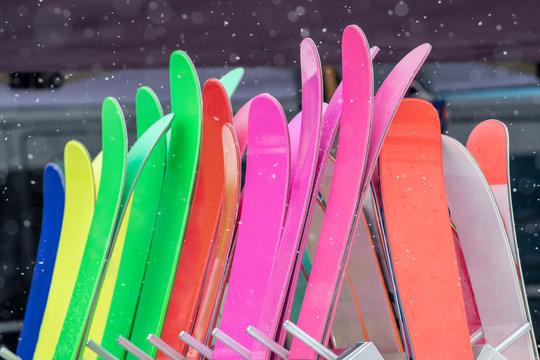 ski rack full of corolful skis