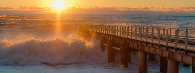 Printed kitchen splashbacks Brown Yellow sun lights big storm waves. Sunset on the sea. Beautiful nature.