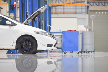 White floor for parking, preparing to repair car pictures in showrooms, parking spaces, waiting for repairs at new branches and car service centers on the epoxy floor in new car factory service.