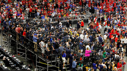 News cameras face the stage at U.S. President Donald Trump's re-election campaign kick-off rally in Orlando