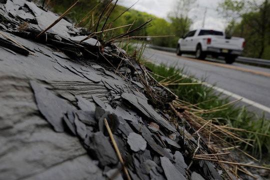 Slate sticks out from the hillside outside of Bangor