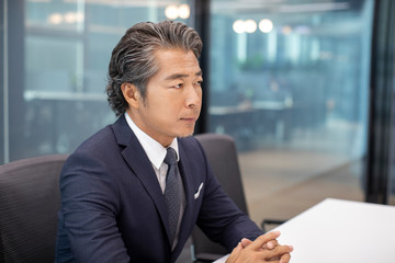 Successful businessman in meeting room