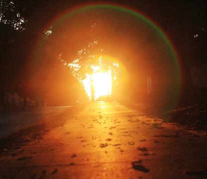 Pavement with glowing light and halo at sunset