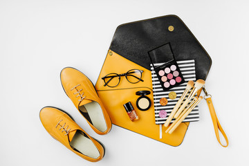 Wall Mural - Flat lay of female fashion accessories, shoes, makeup products and handbag on orange colors. Beauty and fashion concept