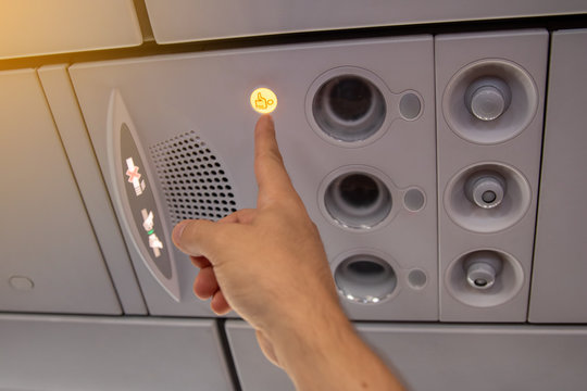Flight attendant call button. Air conditioning in the plane.