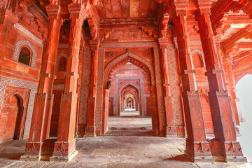 Fatehpur Sikri medieval mughal architecture built of red sandstone with intricate ancient wall art at Agra, India Fototapete