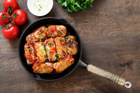 Traditional stuffed cabbage rolls with minced meat and rice, served in a tomato sauce.