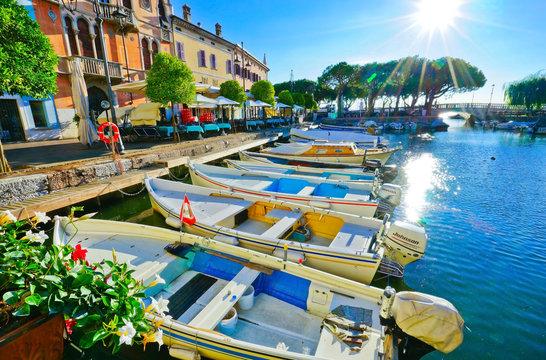 View of Desenzano del Garda at the lakeside of Lake Garda in summer.