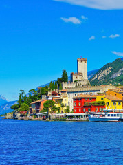 Malcesine at the lakeside of Lake Garda in summer. Lake Garda is a popular holiday location and the largest lake in Italy.