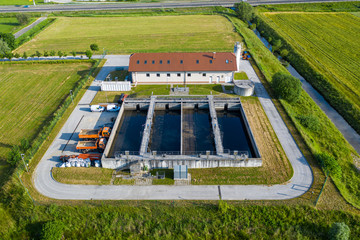 Aerial view of small sewage treatment plant with wastewater tanks and filters