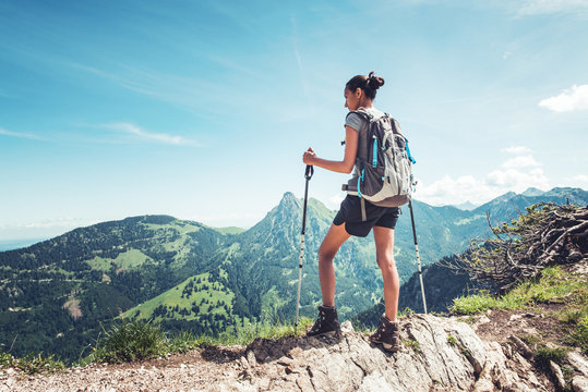 Fit young woman hiking in the mountains