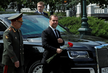 Russian Prime Minister Dmitry Medvedev arrives for a wreath laying ceremony marking the anniversary of the Nazi German invasion in 1941, at the Tomb of the Unknown Soldier by the Kremlin wall in Moscow